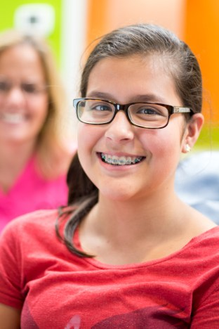 close up face braces glasses Ossi Orthodontics Jacksonville and St. Augustine Florida Orthodontist