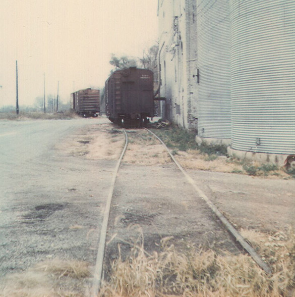 The elevator track with a couple of grain cars spotted for loading