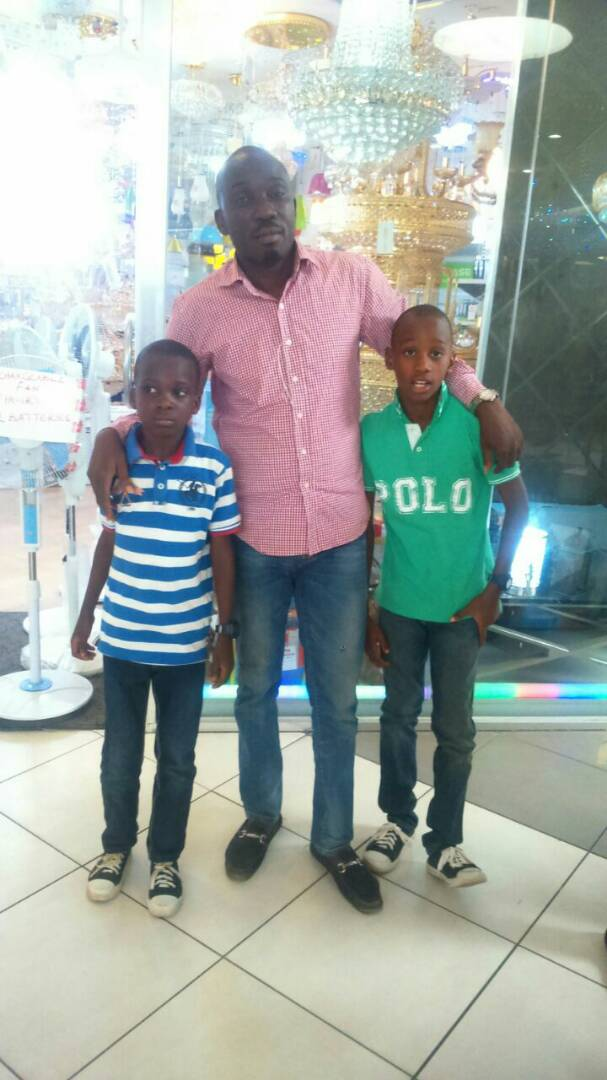 Moyosore and Morolayo Bakre and their father, Ayo Bakre