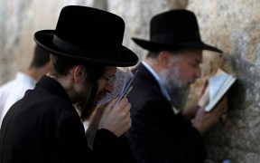 JEWISH WORSHIPPERS PRAY AT WESTERN WALL IN JERUSALEM