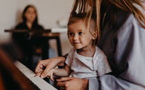Mother and child at piano