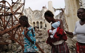 WOMEN PASS DESTROYED CATHEDRAL IN PORT-AU-PRINCE