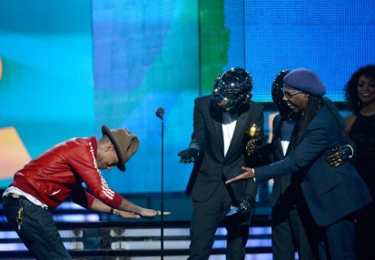 Pharrell Williams bowing to his collaborators Niles Rodgers and Daft Punk after taking home both Record and Album of the Year. Williams' unorthodox headgear also made waves on Twitter and inspired many parodies.  (Photo provided by grammy.com)