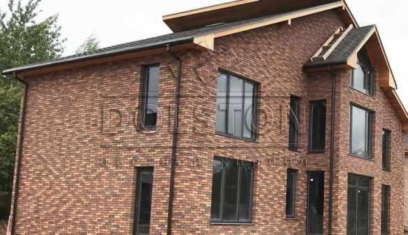 фасад каменного дома из фасадной плитки