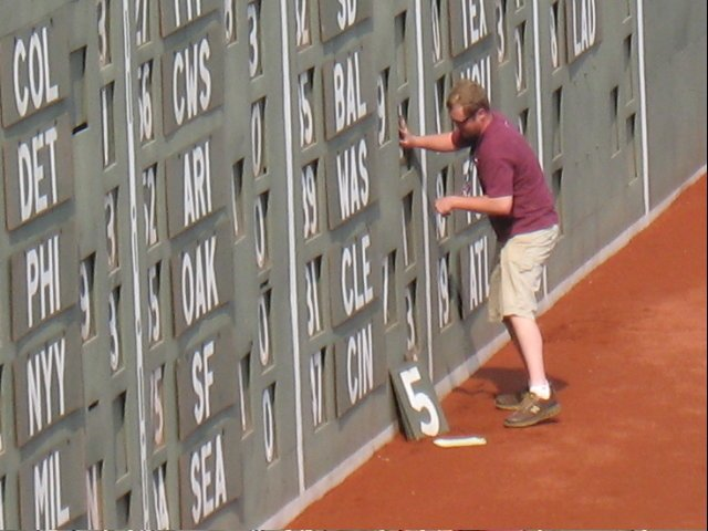 Updating the out-of-town scoreboard is done by hand at Fenway