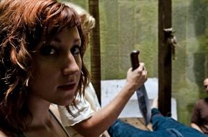 Lauren Lakis as Greta in Rows