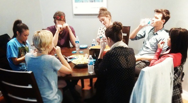 The cast gathers for a heartbreaking game of Cards Against Humanity.