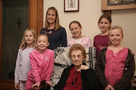 Grandma Evie with all of the granddaughters