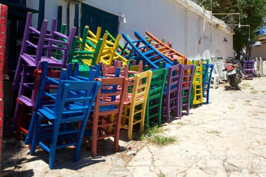 Stack of brightly colored chairs in Kas