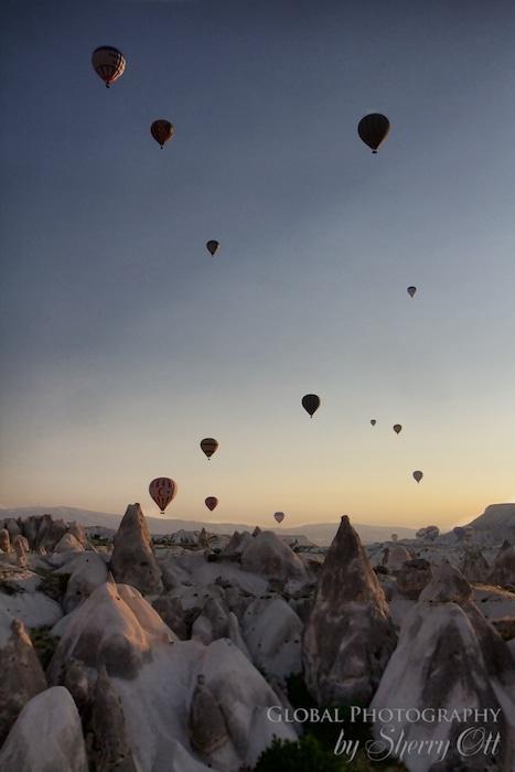 Hot air balloons dot the sky over Cappadocia