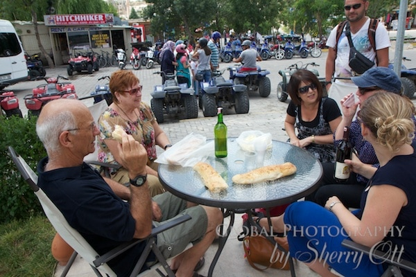 celebrating with wine, bread, and cheese after the tour
