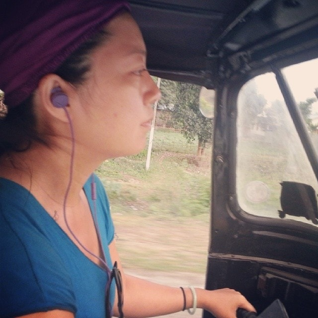 Charlie driving on the Rickshaw Run in India