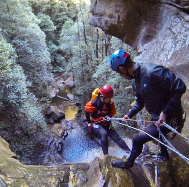 Repelling a waterfall blue mountains