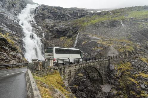 A bus crossing a bridge on Trollstigen Road in Norway