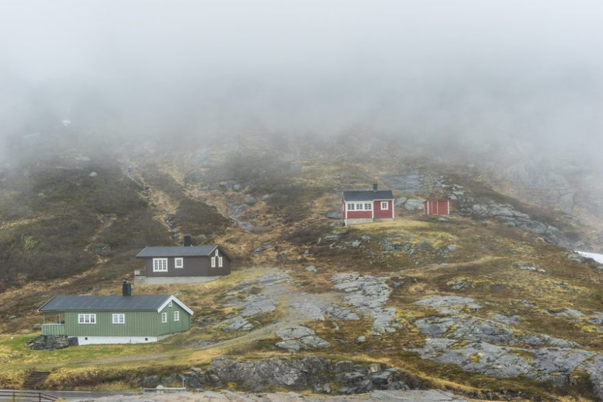 colorful houses on the slopes near Trollstigen road