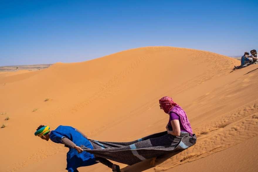 sand sledding morocco desert