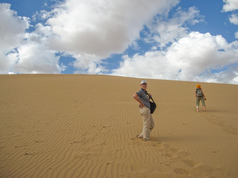 climging sand dunes gobi desert