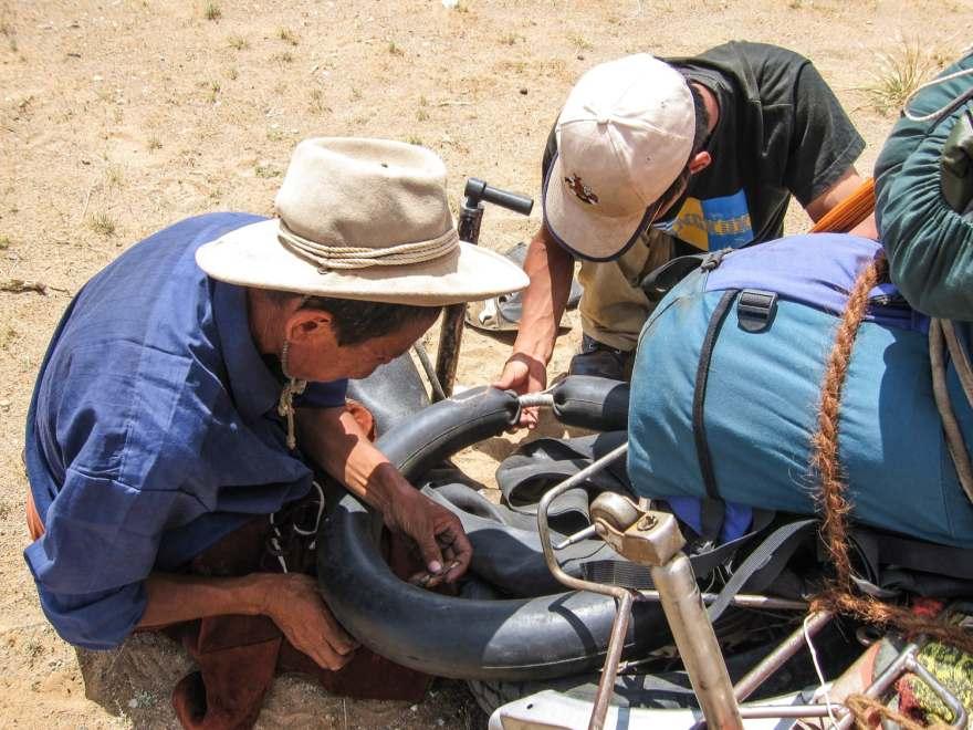 fixing a flat tire mongolia