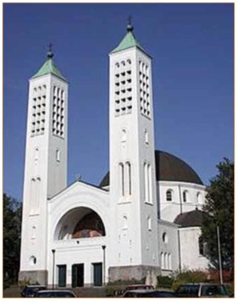 De Cenakelkerk, behorende bij de Heilig Landstichting in Groesbeek bij Nijmegen en gebouwd in 1913-1915, heeft een aparte plaats in het werk van architect Stuyt.