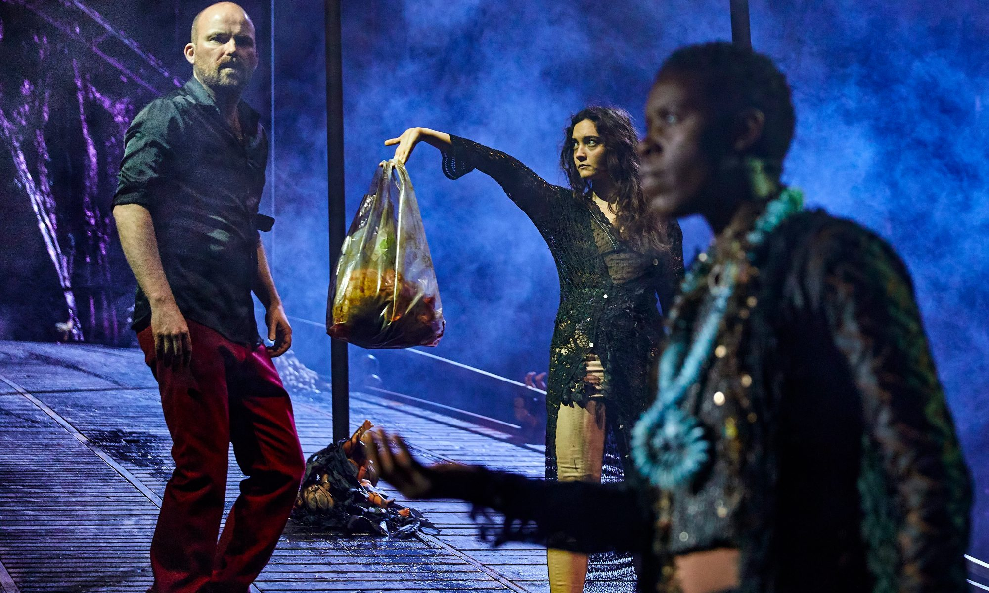 Rory Kinnear as Macbeth, Beatrice Scirocchi as Witch and Anna-Maria Nabirye as Witch in Macbeth at the National Theatre (c) Brinkhoff Mögenburg 1002-1006