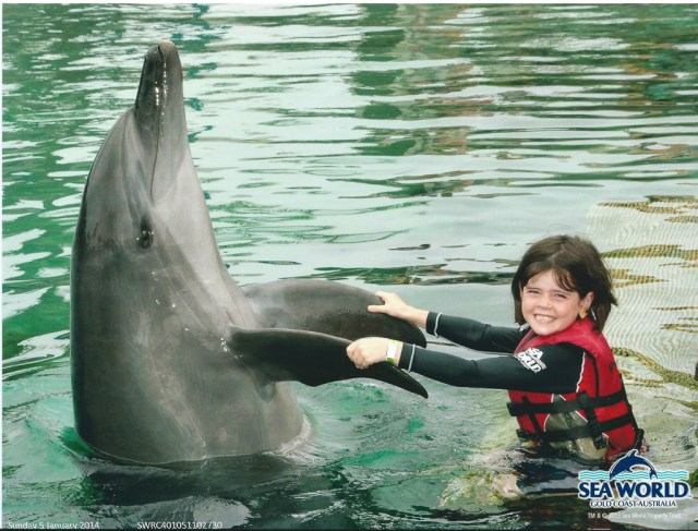 Alannah with Starbuck the dolphin