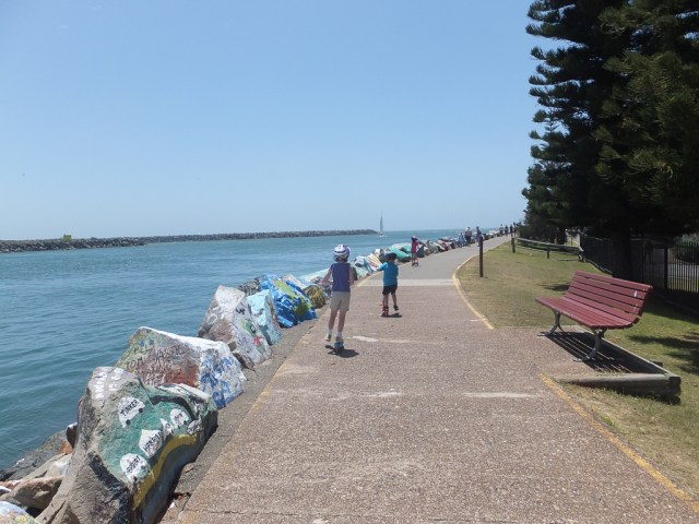 The Port Macquarie Breakwall with the kids on their scooters.