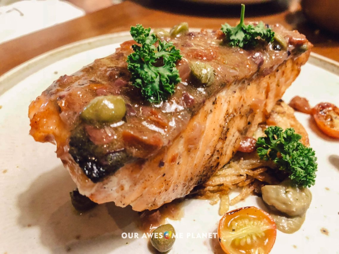 Salmone al Forno (₱795). Roasted salmon, eggplant, capers, and black olives butter sauce.