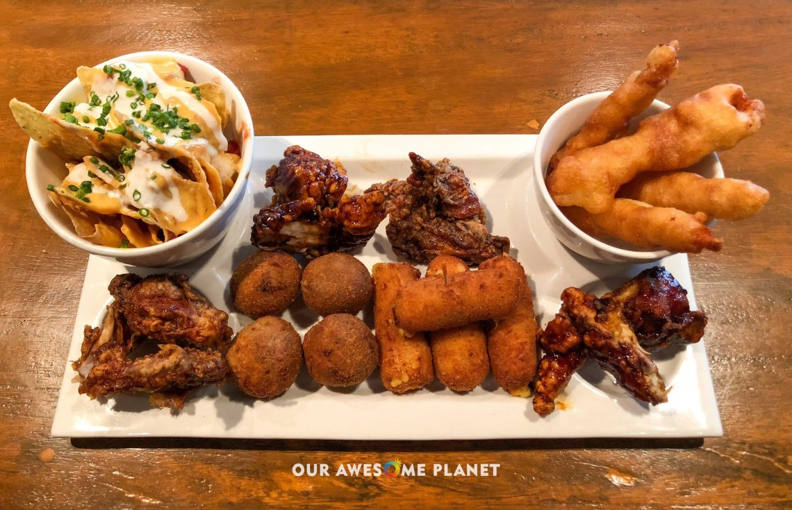 Indios Platter (₱580). Croquettes, Bitterballen, Baked Oyster, Chicken Goujons, Chicken Wings and Nachos