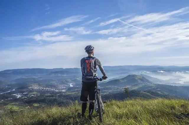 Man Cycling in Mountain