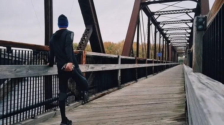 man stretching before running