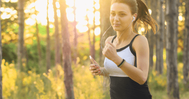 Running woman with earpods