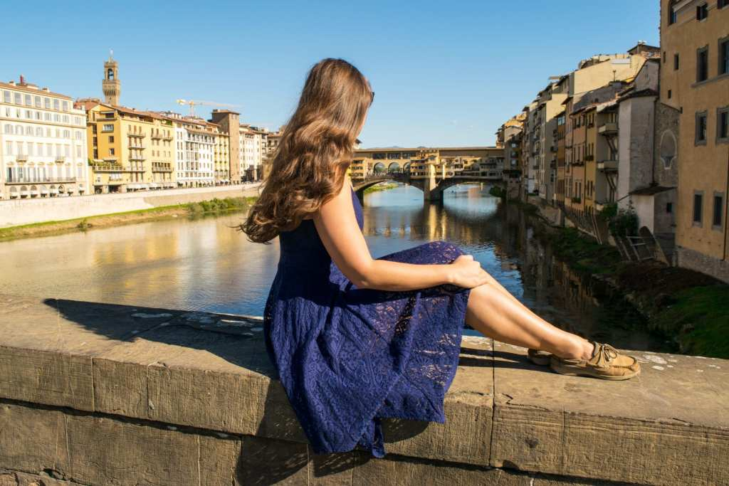 Best Views of Florence: Girl near Ponte Vecchio