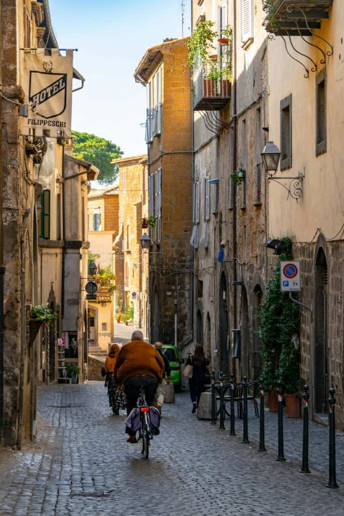 Best Things to Do in Orvieto Italy: Man Riding Bike on Street