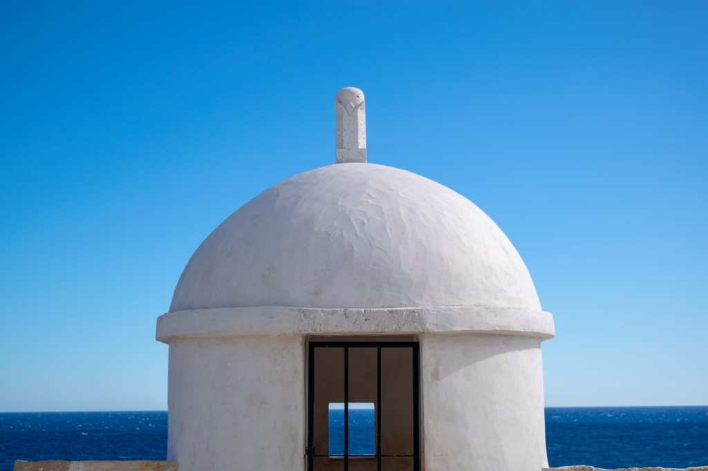 Fun Things to Do in Dubrovnik Croatia: White Dome on city walls with blue sky background