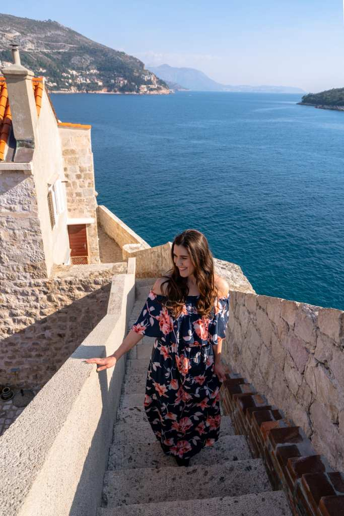 Fun Things to Do in Dubrovnik Croatia: Girl walking staircase on city walls