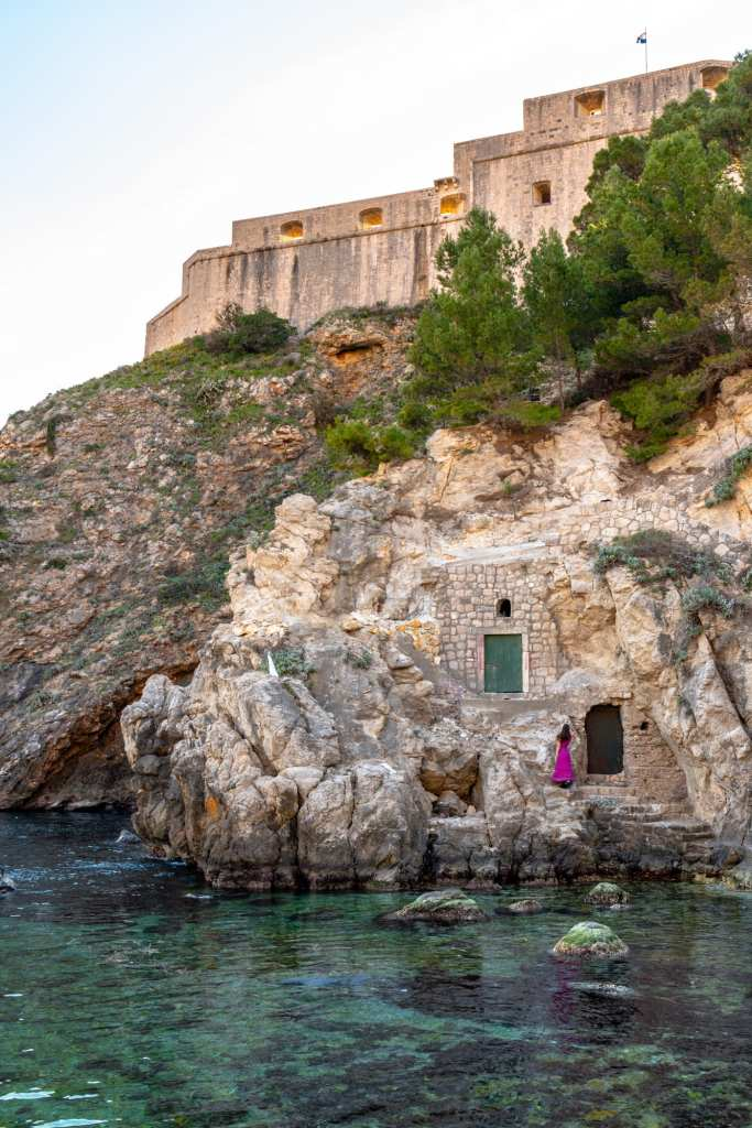 What to Do in Dubrovnik Croatia: West Harbour green doors with Fort Lovrijenac above them