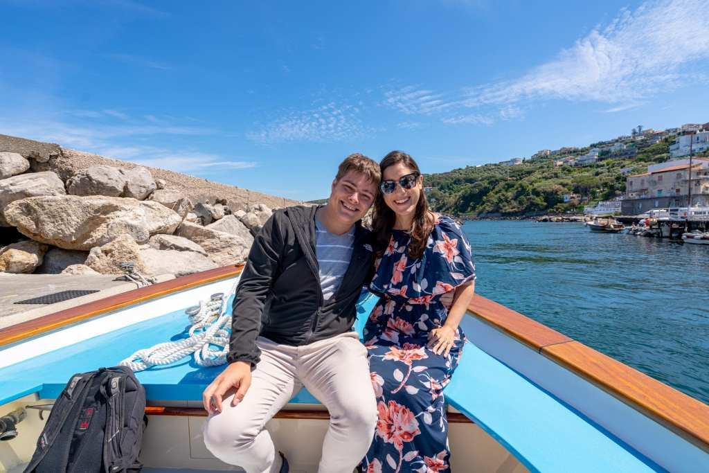 Couple on the bow of a boat bound for a day trip to Capri