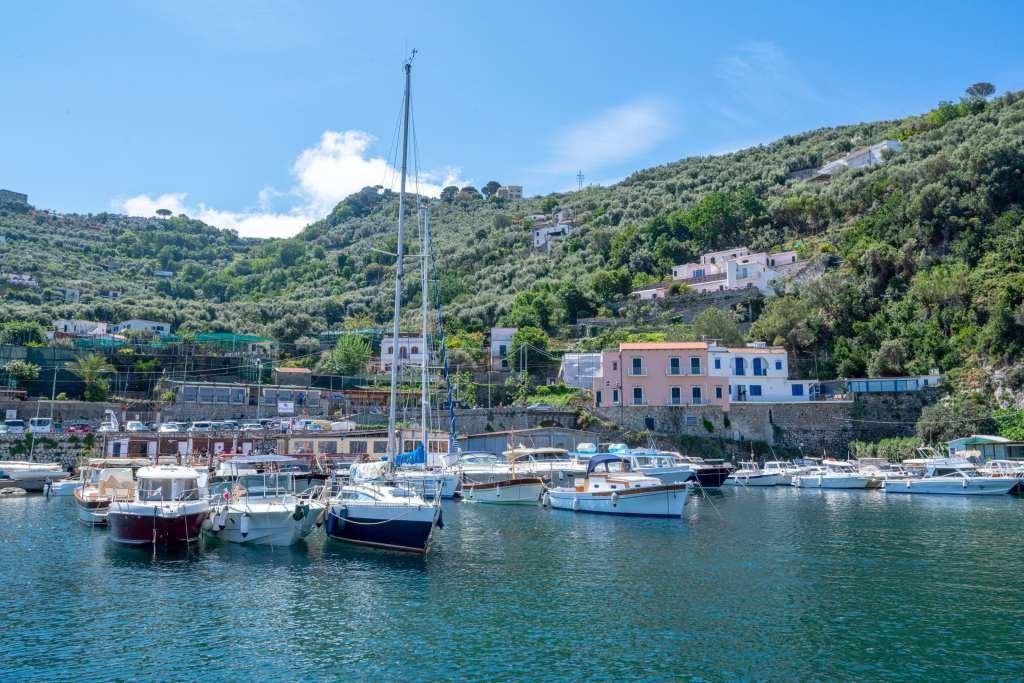 Sailboat in a small harbor near the Amalfi Coast, Italy