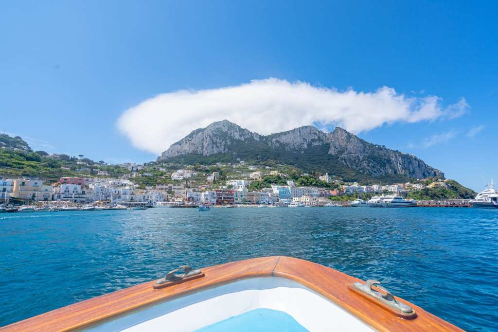 Mariana Grande, Capri, as seen from a boat, with bow of boat in the foreground.