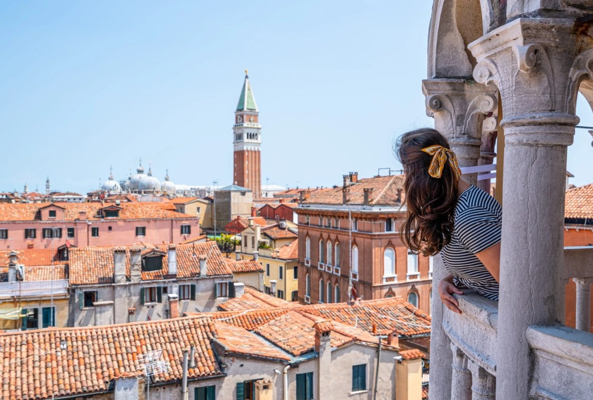 Girl looking toward San Marco Campanile from Scala Contarini del Bovolo, which is an excellent place to visit during 2 days in Venice