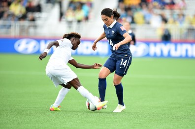 Eniola Aluko and Louisa Nécib (14) during an opening-round match at the 2015 Women's World Cup in Moncton, New Brunswick.