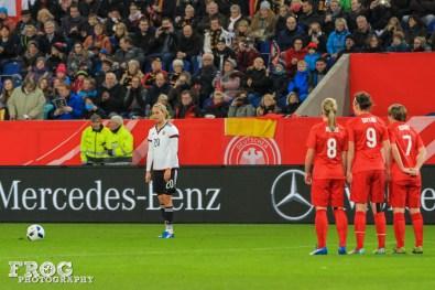 Lena Goeßling (GER) prepares for a free kick.