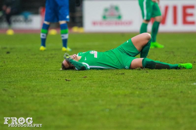 Injured Wolfsburg player.