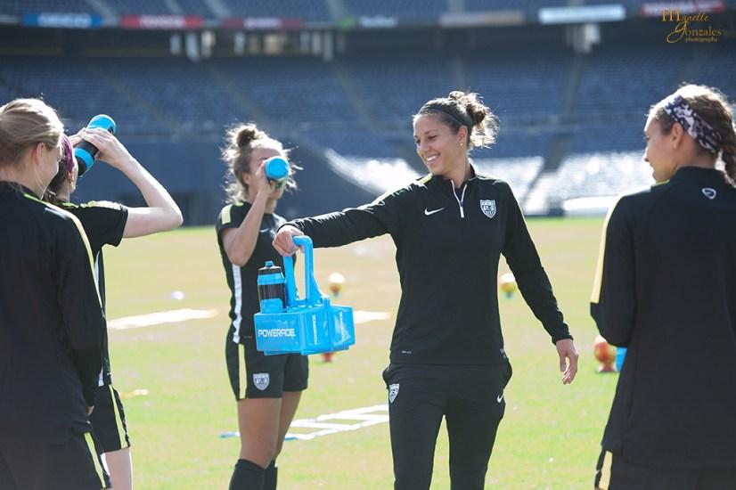 Always helpful, Carli Lloyd during practice.