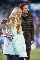Christie Rampone with her daughters and Abby Wambach during a pregame ceremony honoring Rampone for her USWNT career.