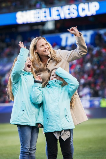 Christie Rampone with her daughters at the 2017 SheBelieves Cup. The pregame ceremony honored Rampone for her USWNT career.