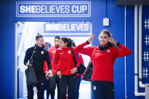 Alex Morgan and USWNT team members heading to training during the SheBelieves Cup.