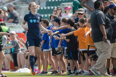 Sam Mewis greeting the high-five line. (Shane Lardinois)