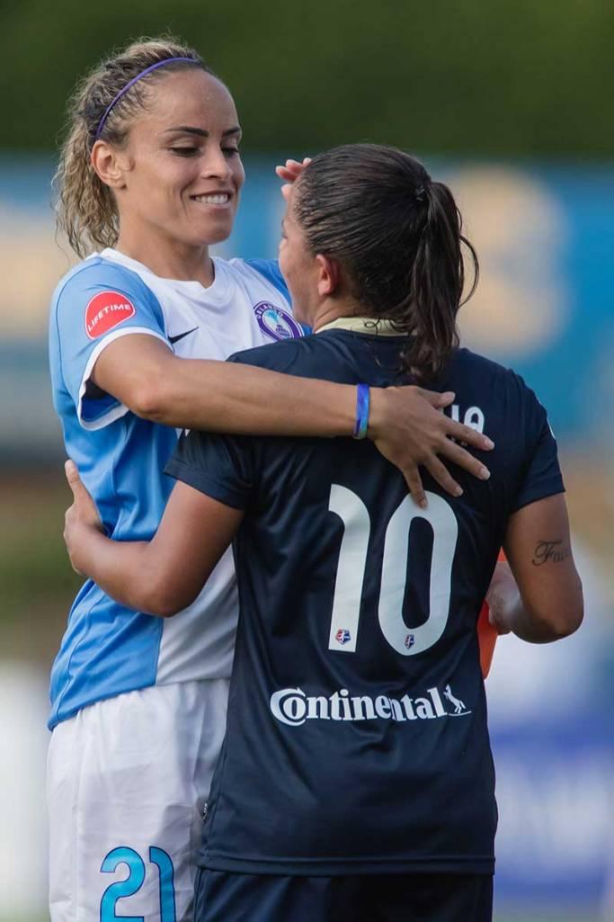 Monica Hickmann Alves and Debinha and postgame hugs. (Shane Lardinois)