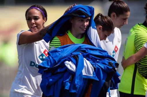 Everyone heldps out. Sydney Leroux and Catherine Parkhill before the game. (Shane Lardinois)